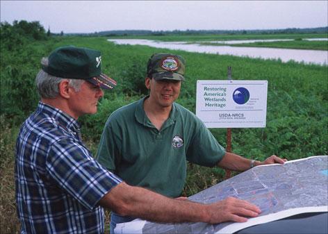 photo of USDA workers in Arkansas wetlands.