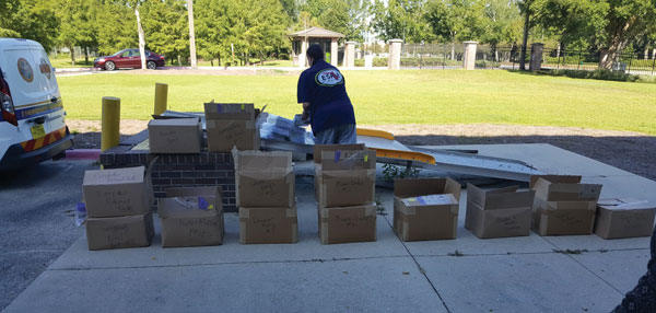 Photo of person opening boxes of USGS maps.